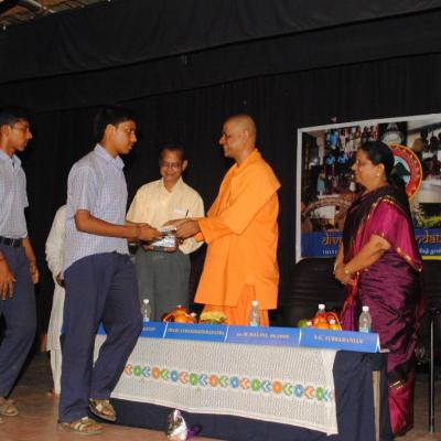 Swamiji Presenting The Books To The Students Of Pshs School
