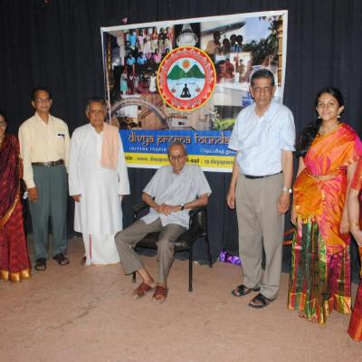Trustees Families In Front Of Divya Prerna Banner